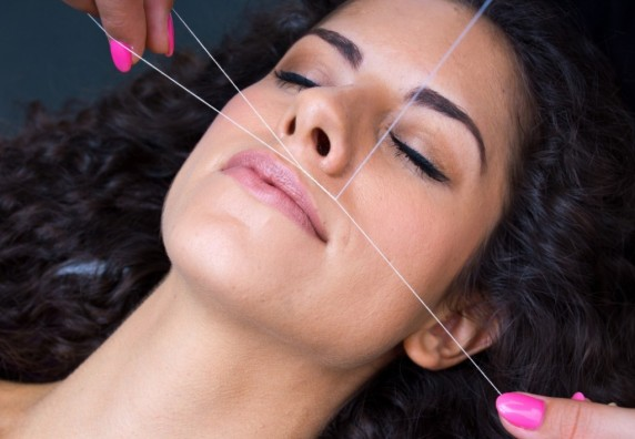 attractive-woman-in-beauty-salon-on-facial-hair-removal-threading-procedure